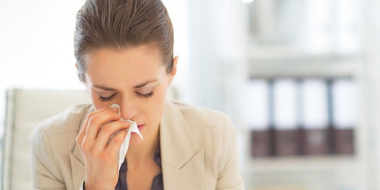 business-woman-sneeze2_shutterstock_192037676-1200-1075x605