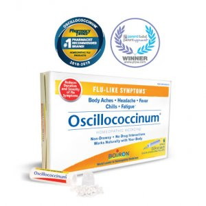Oscillococcinum box and tube with pellets spilled out. Pharmacy Times #1 Homeopathic Flu Medicine and PTPA approved seal.