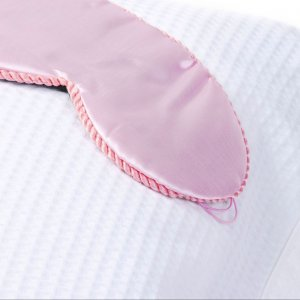 silk eye mask on a pillow
